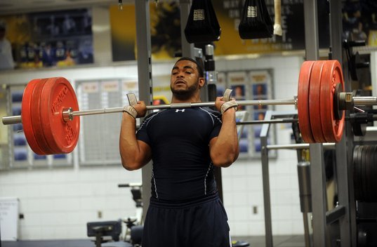Michigan senior Brandon Graham works out at Schembechler Hall in preparation for the NFL Combine in Indianapolis this weekend.  Melanie Maxwell | AnnArbor.com