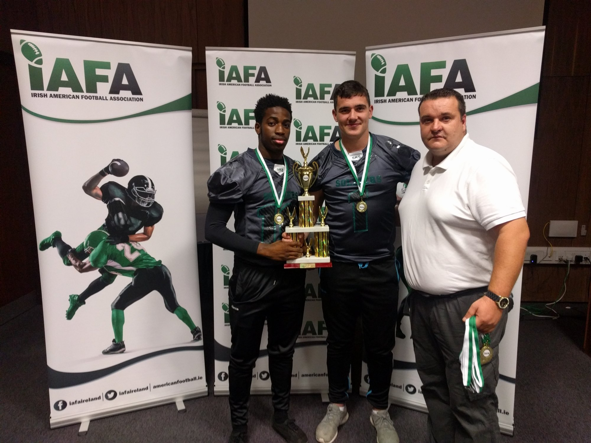 af5ae0a6 Junior Football Director Russell Kerley presenting the trophy to Tomiwa  Oyewo and Jordan Farrell